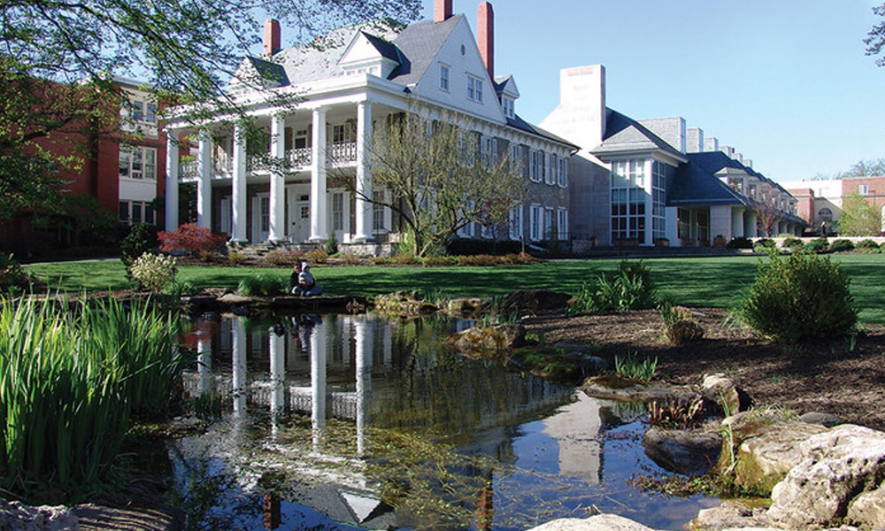 Picture of Hintz Alumni Center taken from across the pond